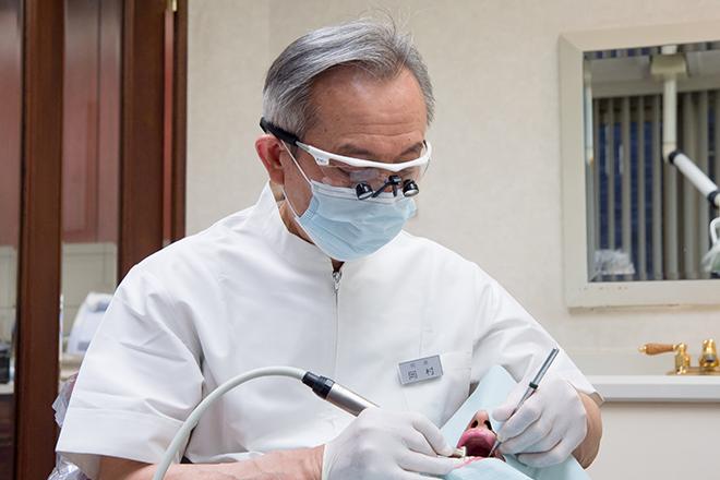 岡村歯科医院の院長先生